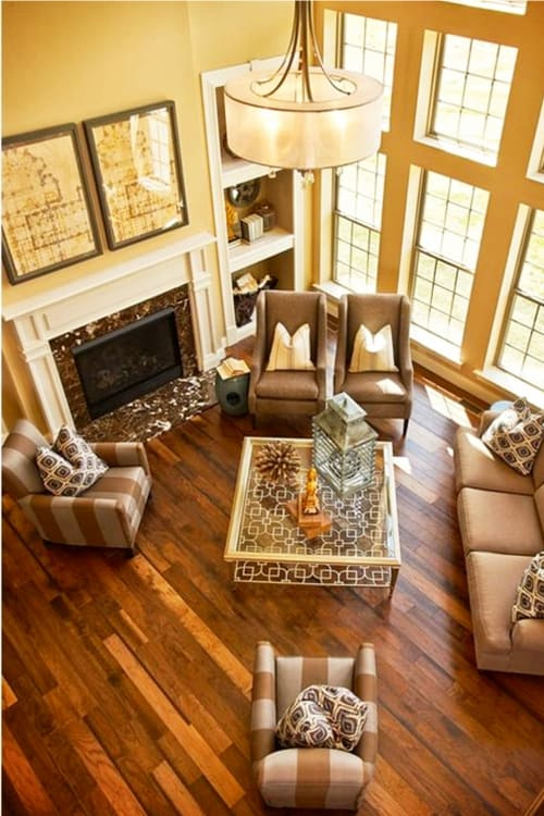 Traditonal living room ideas - this 2 story living room is more modern but sure is a comfy living room with its warm colors.